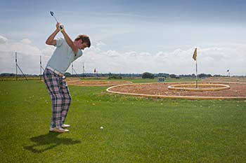 Person playing golf at Searles Norfolk Country Park